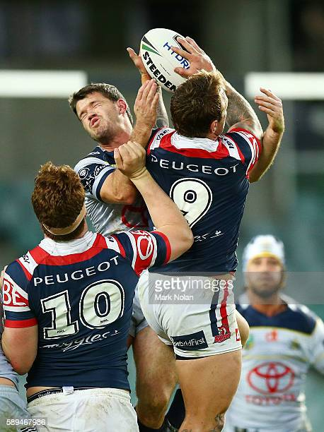 Lachlan Coote of the Cowboys and Jake Friend of the Roosters contest a high ball during the round 23 NRL match between the Sydney Roosters and the...