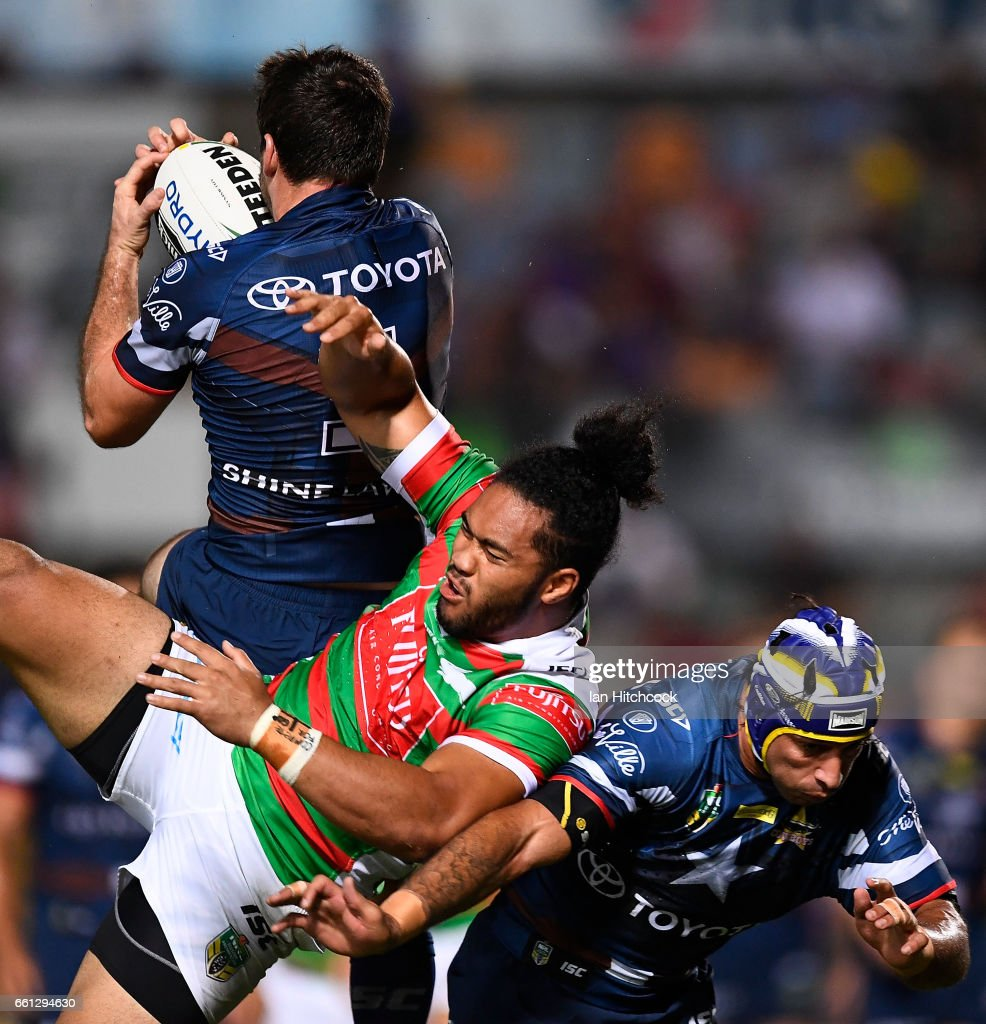Lachlan Coote of the Cowboys catches a high ball over Robert Jennings of the Rabbitohs and Johnathan Thurston of the Cowboys during the round five NRL match between the North Queensland Cowboys and the South Sydney Rabbitohs at 1300SMILES Stadium on March 31, 2017 in Townsville, Australia.