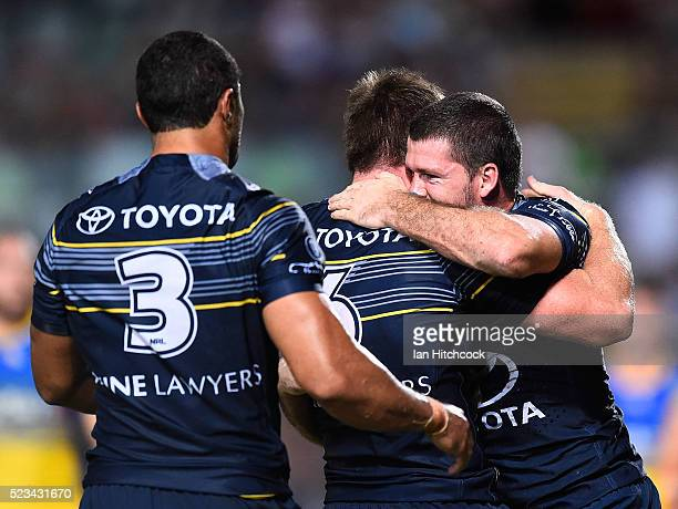 Lachlan Coote of the Cowboys celebrates after scoring a try during the round eight NRL match between the North Queensland Cowboys and the Parramatta...