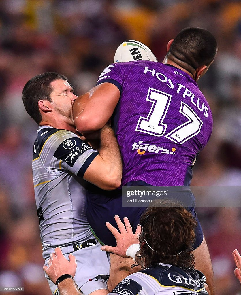 Lachlan Coote of the Cowboys contests a high ball with Nelson Asofa-Solomona of the Storm during the round 10 NRL match between the Melbourne Storm and the North Queensland Cowboys at Suncorp Stadium on May 14, 2016 in Brisbane, Australia.