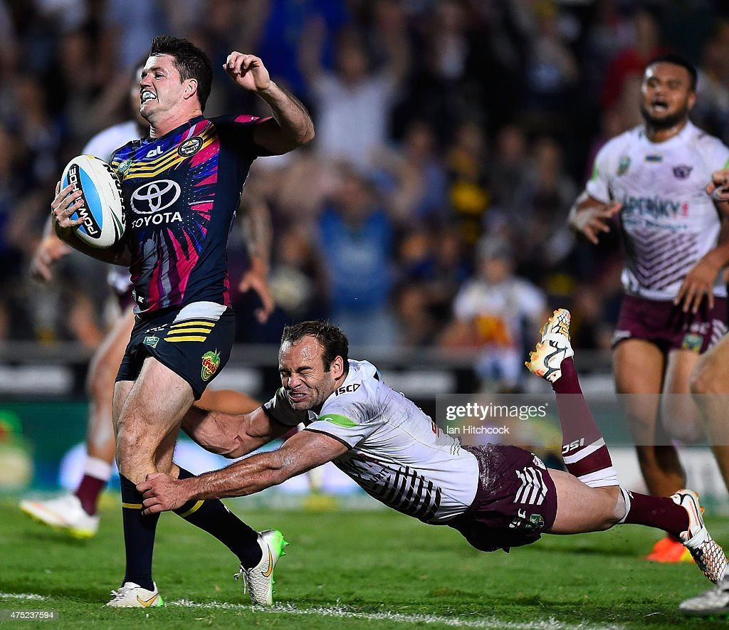 Lachlan Coote of the Cowboys is tackled by Brett Stewart of the Sea Eagles during the round 12 NRL match between the North Queensland Cowboys and the Manly Sea Eagles at 1300SMILES Stadium on May 30, 2015 in Townsville, Australia.
