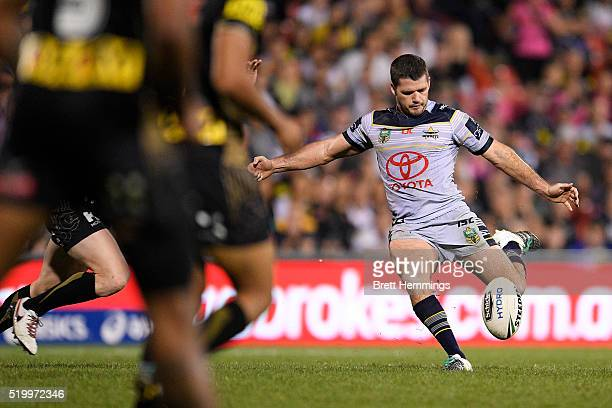 Lachlan Coote of the Cowboys kicks a field goal during the round six NRL match between the Penrith Panthers and the North Queensland Cowboys at...