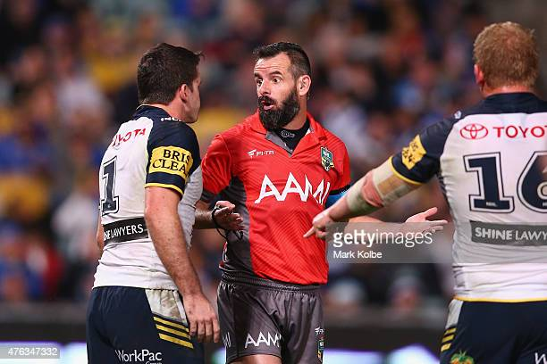 Lachlan Coote of the Cowboys speaks to referee Gavin Bagder during the round 13 NRL match between the Parramatta Eels and the North Queensland...
