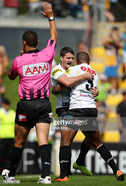 Lachlan Coote of the Panthers celebrates with Wes Naiqama after scoring a try during the round one NRL match between the Penrith Panthers and the...
