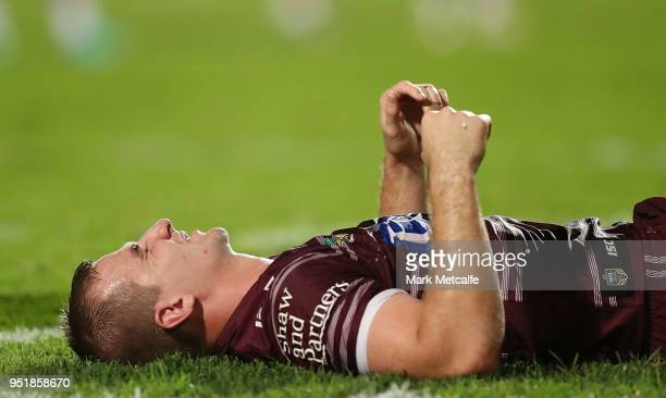 Lachlan Crocker of the Sea Eagles lays down injured during the Round eight NRL match between the ManlyWarringah Sea Eagles and the Newcastle Knights...
