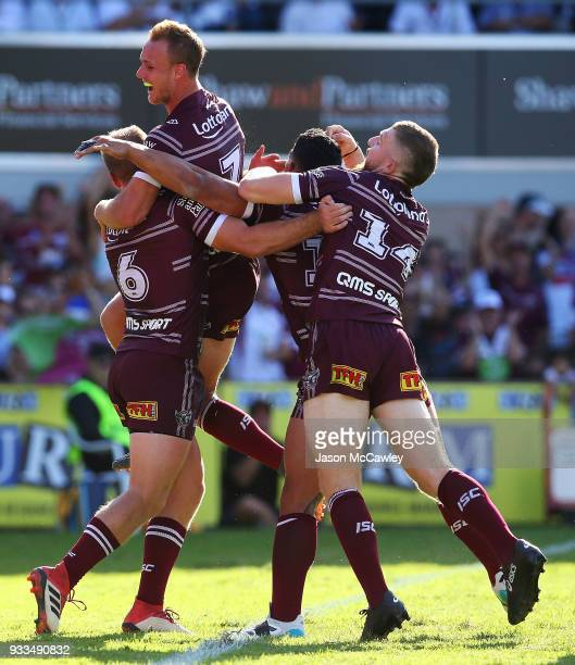 Lachlan Croker of the Sea Eagles celebrates with team mates after scoring a try during the round two NRL match between the Manly Sea Eagles and the...