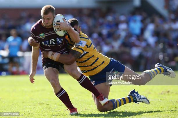 Lachlan Croker of the Sea Eagles is tackled during the round two NRL match between the Manly Sea Eagles and the Parramatta Eels at Lottoland on March...