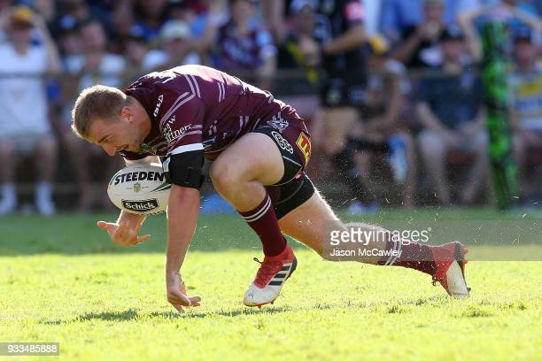 Lachlan Croker of the Sea Eagles scores a try during the round two NRL match between the Manly Sea Eagles and the Parramatta Eels at Lottoland on...