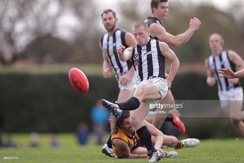 Lachlan Ferguson of Collingwood Magpies kicks the ball during the round 20 VFL match between the Box Hill Hawks and the Collingwood Magpies at Box Hill City Oval on August 20, 2016 in Melbourne, Australia.
