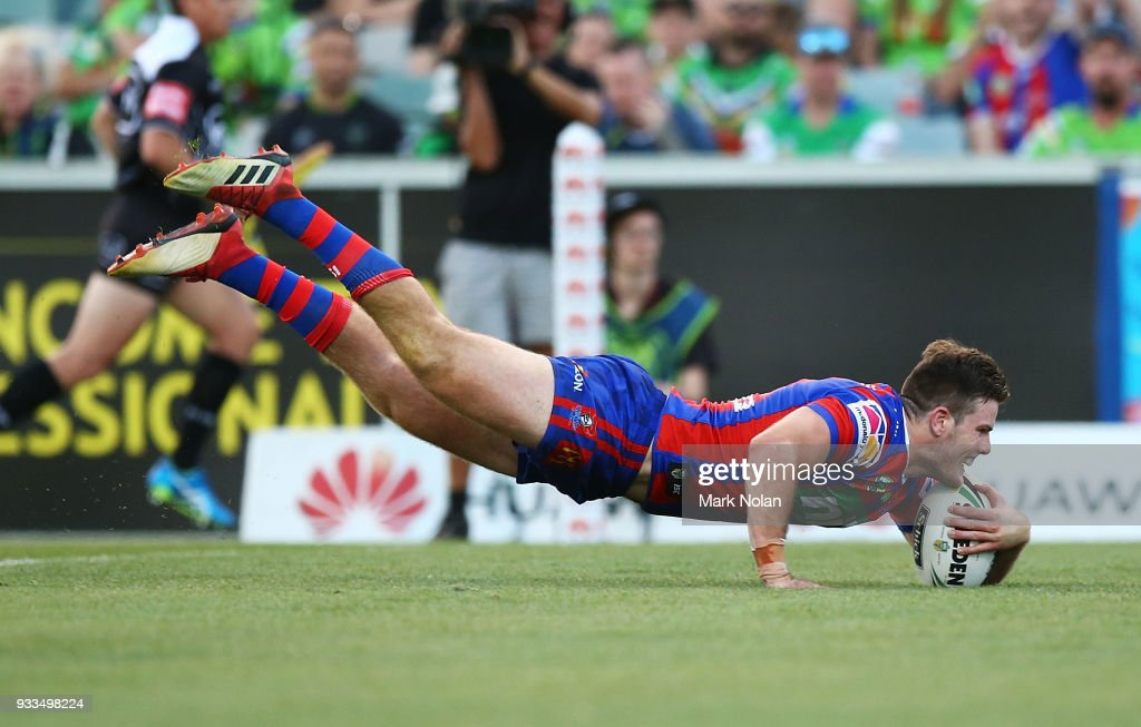 Lachlan Fitzgibbon of the Knights dives to score a try during the round two NRL match between the Canberra Raiders and the Newcastle Knights at GIO Stadium on March 18, 2018 in Canberra, Australia.