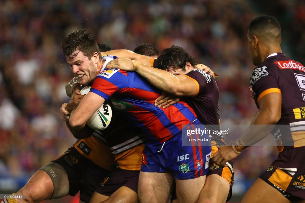 Lachlan Fitzgibbon of the Knights is tackled during the round five NRL match between the Newcastle Knights and the Brisbane Broncos at McDonald Jones Stadium on April 7, 2018 in Newcastle, Australia.