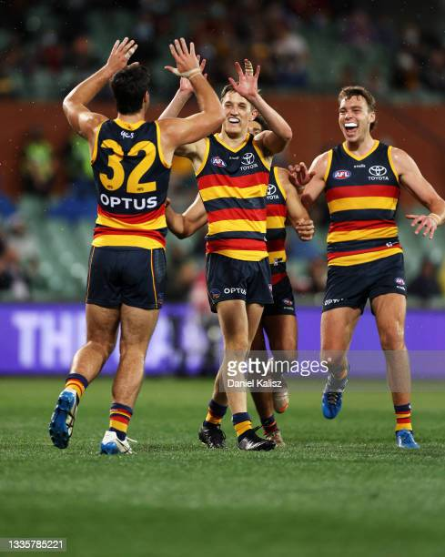 Lachlan Gollant of the Crows celebrates after kicking a goal during the round 23 AFL match between Adelaide Crows and North Melbourne Kangaroos at...