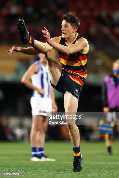 Lachlan Gollant of the Crows kicks for goal during the round 23 AFL match between Adelaide Crows and North Melbourne Kangaroos at Adelaide Oval on...