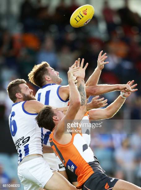 Lachlan Hansen and Luke McDonald of the Kangaroos compete for the ball against Rory Lobb of the Giants during the JLT Community Series AFL match...