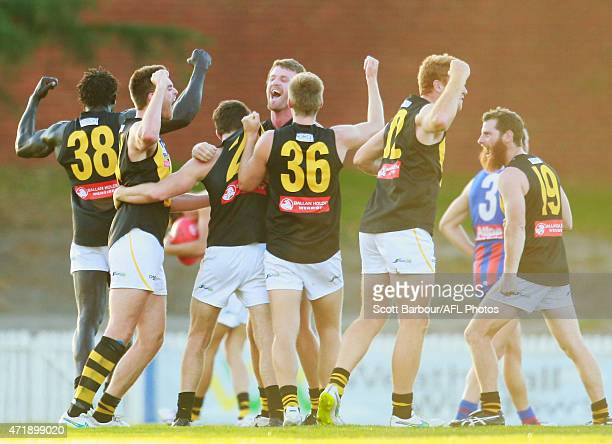 Lachlan Hansen, Majak Daw and the Werribee Tigers celebrate after winning the round three VFL match between Port Melbourne and Werribee Tigers at...