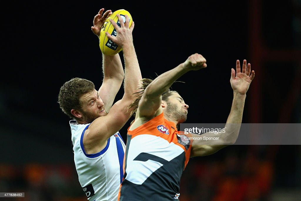 Lachlan Hansen of the Kanagaroos marks over Callan Ward of the Giants during the round 12 AFL match between the Greater Western Sydney Giants and the North Melbourne Kangaroos at Spotless Stadium on June 20, 2015 in Sydney, Australia.