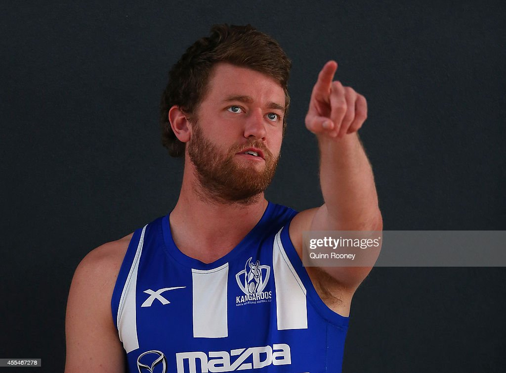 Lachlan Hansen of the Kangaroos points during a North Melbourne Kangaroos AFL training session at Arden Street Ground on September 15, 2014 in Melbourne, Australia.