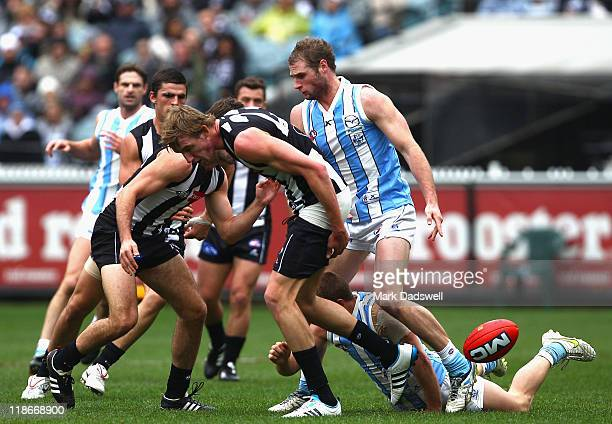 Lachlan Keefe of the Magpies pulls his pants up after a tackle during the round 16 AFL match between the Collingwood Mgapies and the North Melbourne...