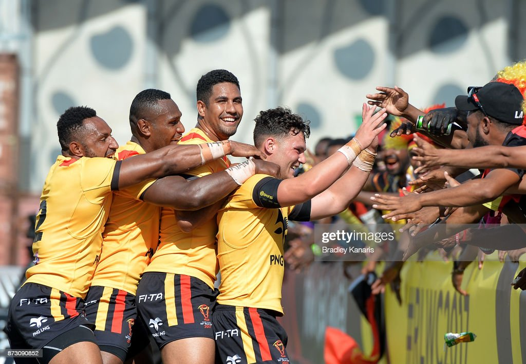 Lachlan Lam of Papua New Guinea celebrates with the fans after scoring try during the 2017 Rugby League World Cup match between Papua New Guinea and the United States on November 12, 2017 in Port Moresby, Papua New Guinea.
