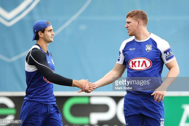 Lachlan Lewis and Dylan Napa shake hands during a Canterbury Bulldogs NRL training session at Belmore Sports Ground on March 19, 2019 in Sydney,...