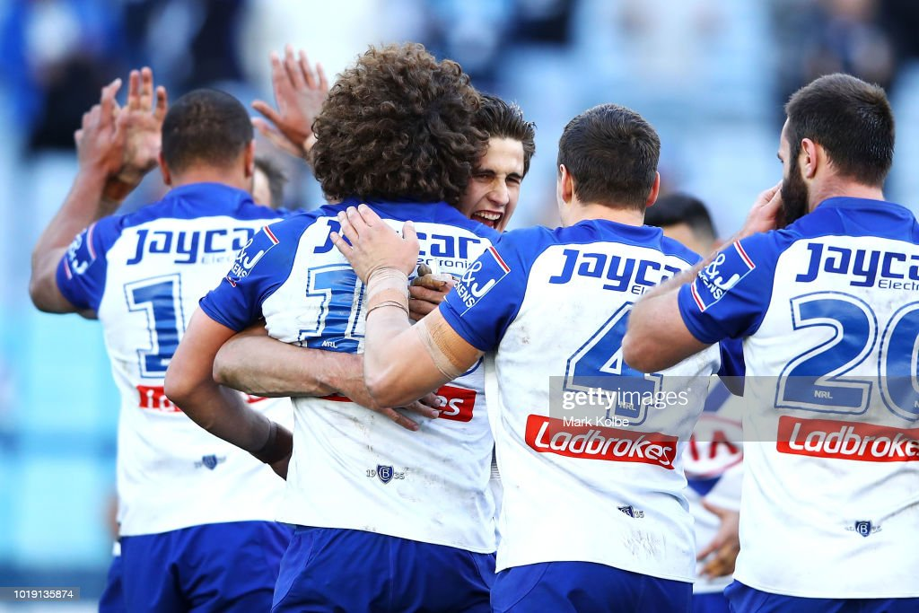 Lachlan Lewis of the Bulldogs celebrates victory with his team mates during the round 23 NRL match between the Canterbury Bulldogs and the New Zealand Warriors at ANZ Stadium on August 19, 2018 in Sydney, Australia.