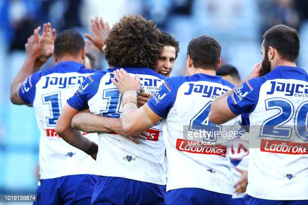 Lachlan Lewis of the Bulldogs celebrates victory with his team mates during the round 23 NRL match between the Canterbury Bulldogs and the New...