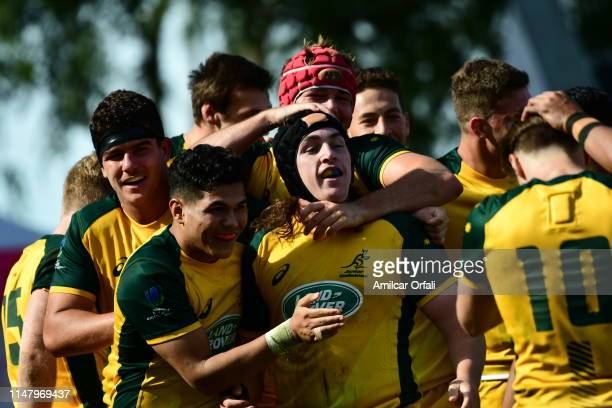 Lachlan Lonergan of Australia U20 celebrates with his teammates after scoring a try during a first round match between Australia U20 and Italy U20 as...