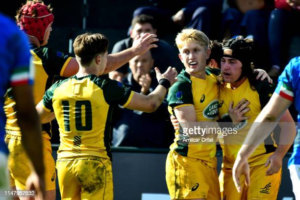 Lachlan Lonergan of Australia U20 celebrates with teammates after scoring a try during a first round match between Australia U20 and Italy U20 as...