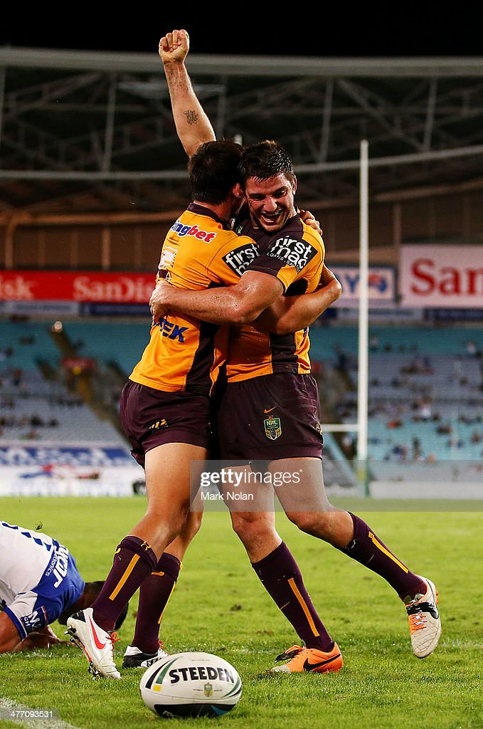 Lachlan Maranta and Matt Gillett of the Broncos celebrate a try by Maranta during the round one NRL match between the Canterbury-Bankstown Bulldogs and the Brisbane Broncos at ANZ Stadium on March 7, 2014 in Sydney, Australia.