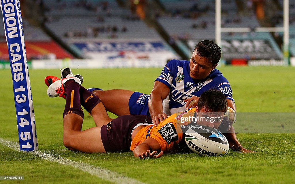 Lachlan Maranta of the Broncos dives to score a try during the round one NRL match between the Canterbury-Bankstown Bulldogs and the Brisbane Broncos at ANZ Stadium on March 7, 2014 in Sydney, Australia.