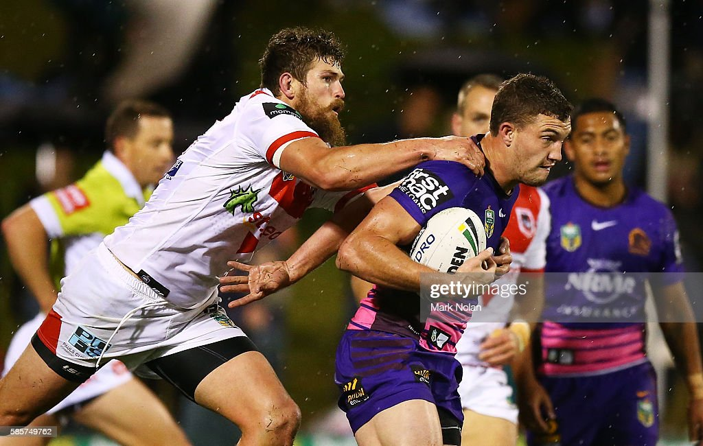 Lachlan Maranta of the Broncos is tackled during the round 22 NRL match between the St George Illawarra Dragons and the Brisbane Bronocs at WIN Stadium on August 4, 2016 in Wollongong, Australia.