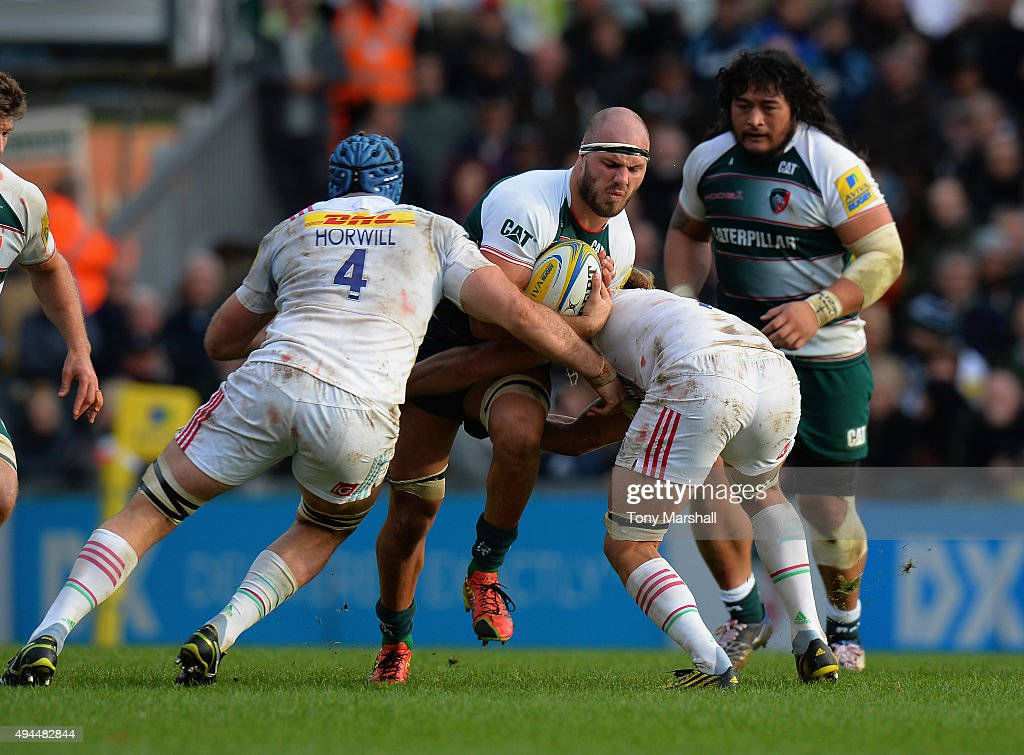 Lachlan McCaffrey of Leicester Tigers is tackled by James Horwill and Luke Wallace of Harlequins during the Aviva Premiership match between Leicester Tigers and Harlequins at Welford Road on October 25, 2015 in Leicester, England.