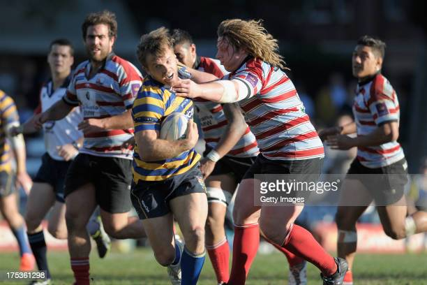 Lachlan Mitchel runs with the ball during the round 16 Shute Shield match between Sydney Uni and Southern Districts at North Sydney Oval on August 3...