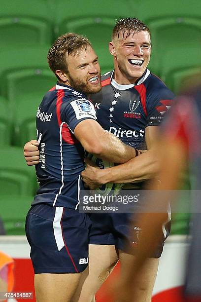 Lachlan Mitchell and Jason Woodward of the Rebels celebrate a try during the round three Super Rugby match between the Melbourne Rebels and the...