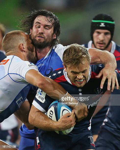 Lachlan Mitchell of the Rebels is tackled during the round one Super Rugby match between the Rebels and the Force at AAMI Park on February 15 2013 in...