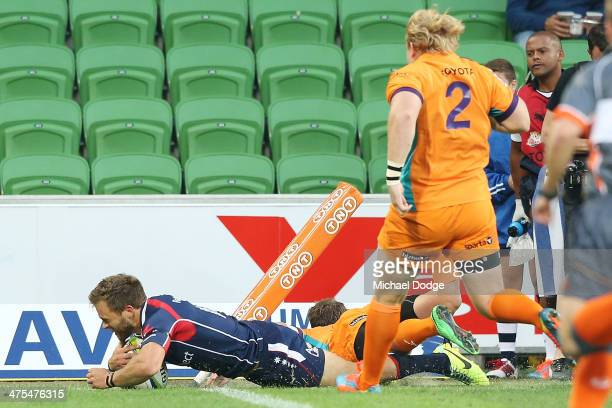 Lachlan Mitchell of the Rebels scores a try during the round three Super Rugby match between the Melbourne Rebels and the Cheetahs at AAMI Park on...