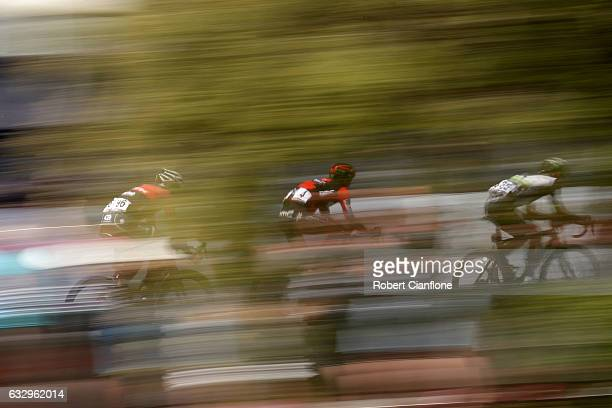 Lachlan Morton of Australia and Team Dimension Data is chased by Amael Moinard of France and BMC Racing Team and Koen De Kort of the Netherkands and...