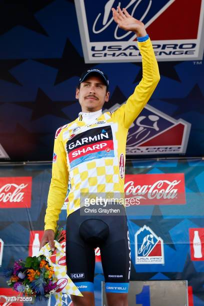 Lachlan Morton of Australia and Team GarminSharp poses for a photo on the podium in the yellow Smashburger Leader's jersey following stage three of...