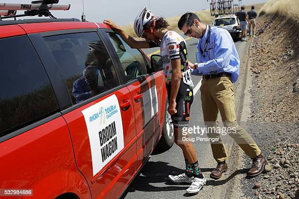 Lachlan Morton of Australia riding for Jelly Belly presented by Maxxis has his race number removed by a commissaire as he abandons the race during...
