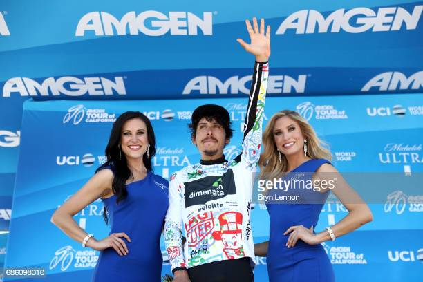 Lachlan Morton of Australia riding for Team Dimension Data in the TAG Heuer Best Young Rider jersey poses for a photo on the stage following the 2017...