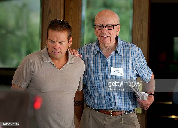 Lachlan Murdoch a board member of News Corp left speaks with his father Rupert Murdoch chairman and chief executive officer of News Corp at the Allen...