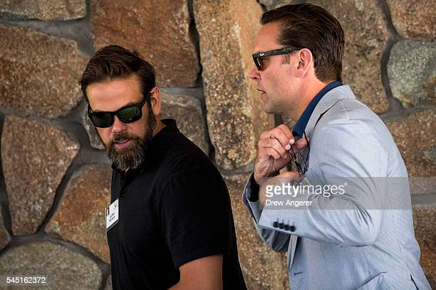 Lachlan Murdoch executive cochairman of News Corp and 21st Century Fox walks with brother James Murdoch chief executive officer of 21st Century Fox...