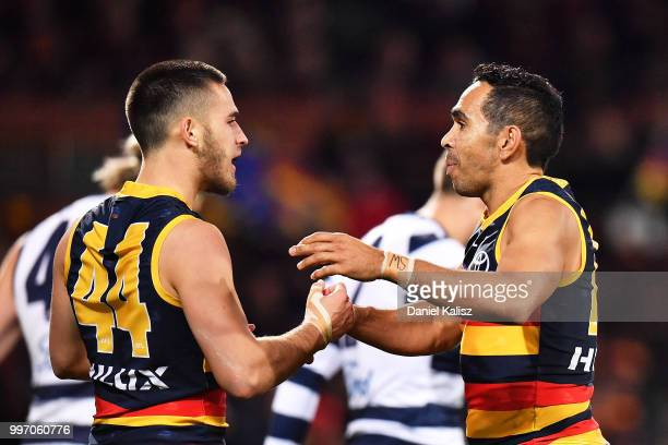Lachlan Murphy of the Crows and Eddie Betts of the Crows celebrate during the round 17 AFL match between the Adelaide Crows and the Geelong Cats at...