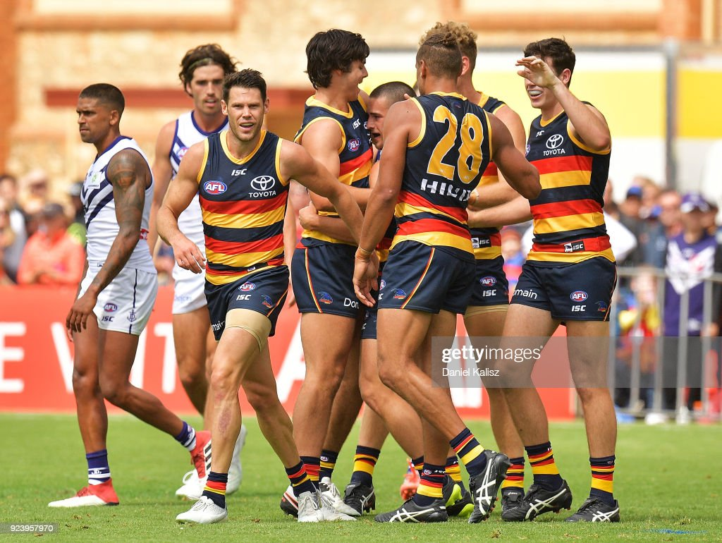 Lachlan Murphy of the Crows celebrates with his team mates after kicking a goal during the JLT Community Series AFL match between the Adelaide Crows and the Fremantle Dockers at Strathalbyn Oval on February 25, 2018 in Adelaide, Australia.
