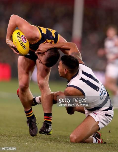 Lachlan Murphy of the Crows is tackled by Tim Kelly of the Cats during the 2018 AFL round 17 match between the Adelaide Crows and the Geelong Cats at...