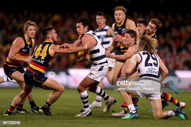 Lachlan Murphy of the Crows tackles Sam Simpson of the Cats during the 2018 AFL round 17 match between the Adelaide Crows and the Geelong Cats at...