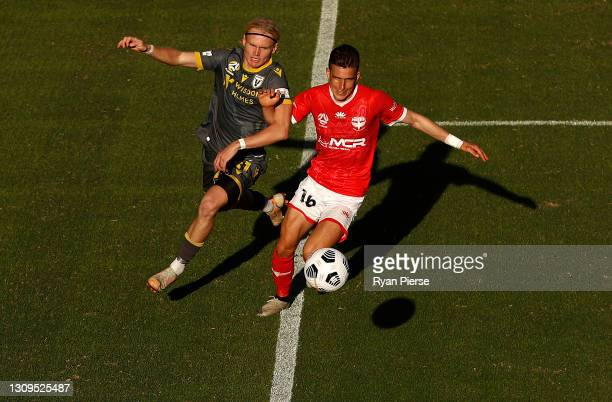 Lachlan Rose of Macarthur FC competes for the ball against Louis Fenton of the Phoenix during the A-League match between Wellington Phoenix and...