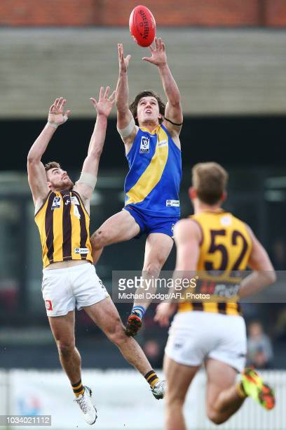 Lachlan Schultz of Williamstown marks the ball against Mitchell OÕDonnell of the Hawks during the VFL Preliminary Final match between Williamstown...