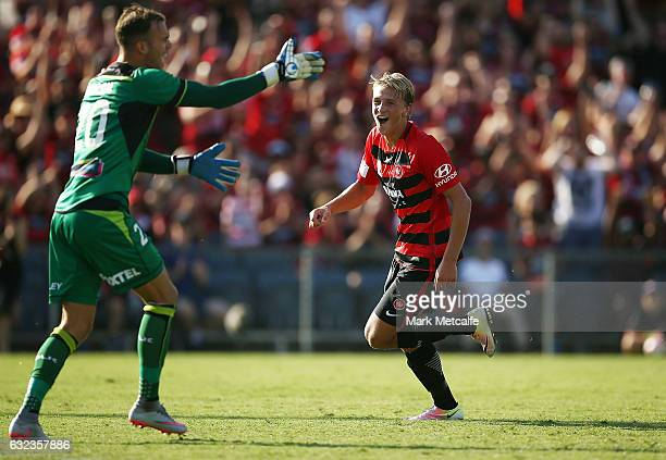 Lachlan Scott of the Wanderers celebrates scoring a goal as Jack Duncan of the Jets reacts during the round 16 ALeague match between the Western...