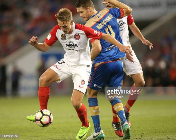 Lachlan Scott of the Wanderers contests the ball with Nigel Boogaard of the Jets during the round 25 ALeague match between the Newcastle Jets and the...